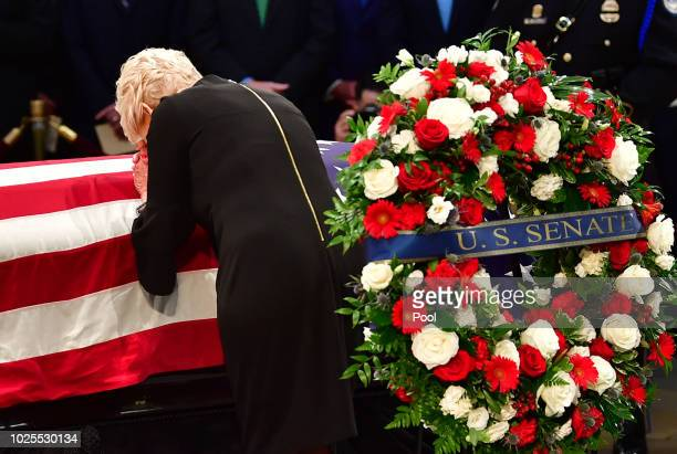 Cindy McCain leans over the casket of former Senator John McCain in the Capitol Rotunda where he will lie in state at the US Capitol in Washington DC...