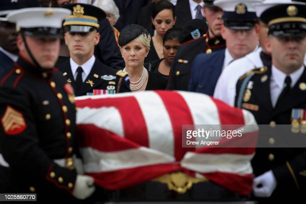 Cindy McCain looks on as a joint military service casket team carries the casket of the late Senator John McCain following his funeral service at the...