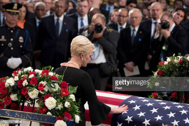 Cindy McCain pays her respects to the flagdraped casket bearing the remains of her husband John McCain who lived and worked in Congress over four...