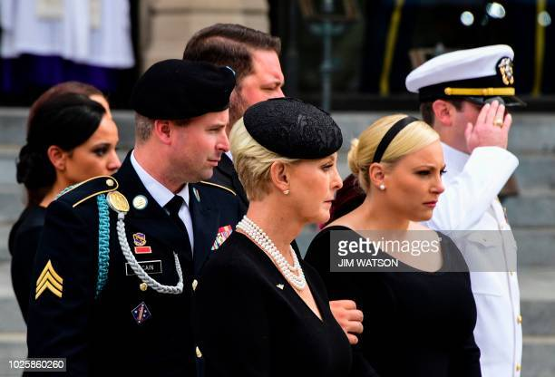 Cindy McCain the widow of US Senator John McCain and her sons and daughters look on as a Military Honor Guard places the casket of US Senator John...
