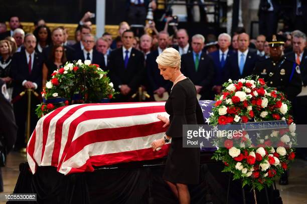 Cindy McCain touches the casket of former Senator John McCain in the Capitol Rotunda where he will lie in state at the US Capitol in Washington DC on...