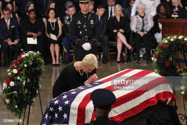 Cindy McCain wife of John McCain touches the casket during the ceremony honoring the late US Senator inside the Rotunda of the US Capitol August 31...