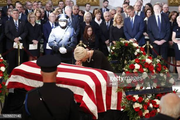 Cindy McCain wife of late US Senator John McCain kneels at her husband's casket during ceremonies honoring the late US Senator John McCain inside the...