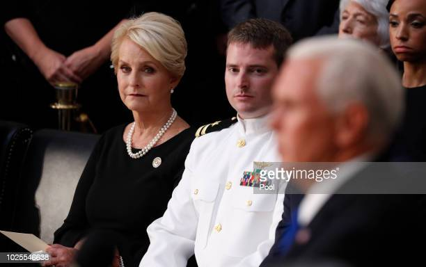 Cindy McCain wife of late US Senator John McCain listens with her son John as Vice President Mike Pence speaks during ceremonies of the late US...
