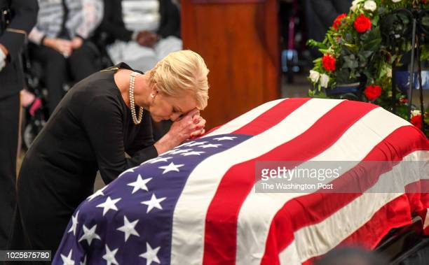 Cindy McCain wife of lateSen John S McCain says a prayer at his casket as he lies in state during a ceremony to honor the sixterm senator from...