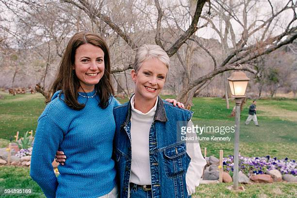 Cindy McCain wife of presidential candidate John McCain poses with a staffer at the McCain ranch March 9 2000 near Sedona Arizona