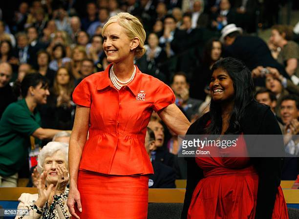 Cindy McCain wife of presumptive Republican presidential nominee US Sen John McCain and their daughter Bridget stand together on day two of the...