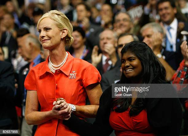 Cindy McCain wife of presumptive Republican presidential nominee US Sen John McCain and their daughter Bridget hold hands on day two of the...