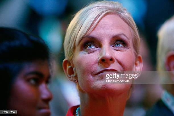 Cindy McCain wife of presumptive Republican presidential nominee US Sen John McCain looks up while her daughter Bridget looks on during day two of...