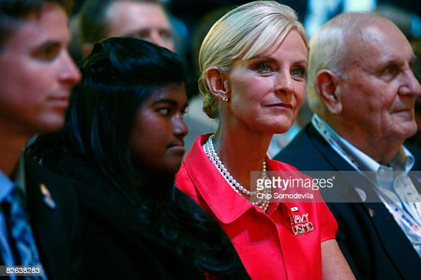 Cindy McCain wife of presumptive Republican presidential nominee US Sen John McCain and their daughter Bridget sit together on day two of the...