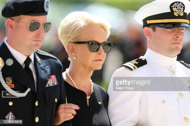 Cindy McCain wife of Sen John McCain is escorted to the Arizona State Capitol Rotunda where her husband's body will lie in state on August 29 2018 in...