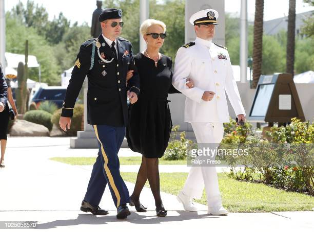 Cindy McCain wife of Sen John McCain is escorted to the Arizona State Capitol Rotunda by her sons Jack and Jimmy where her husbands' body will lie in...