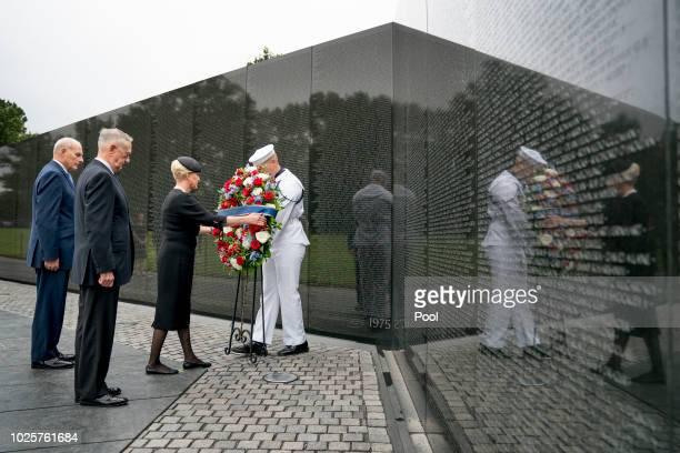Cindy McCain wife of Sen John McCain RAriz accompanied by President Donald Trump's Chief of Staff John Kelly left and Defense Secretary Jim Mattis...