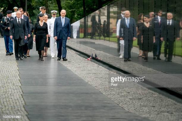 Cindy McCain wife of Sen John McCain RAriz accompanied by President Donald Trump's Chief of Staff John Kelly right Defense Secretary Jim Mattis and...