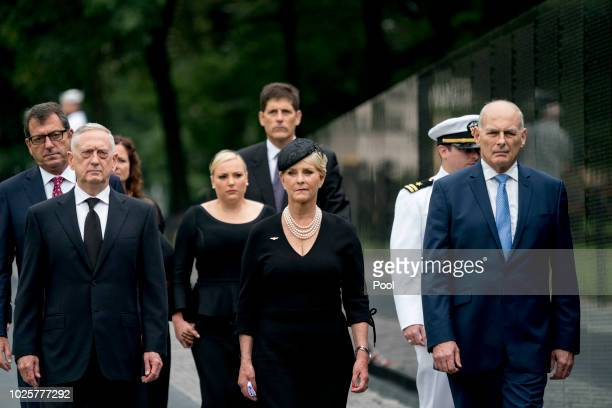 Cindy McCain wife of Sen John McCain RAriz center accompanied by President Donald Trump's Chief of Staff John Kelly right Defense Secretary Jim...