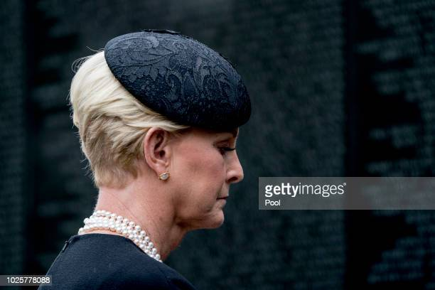 Cindy McCain wife of Sen John McCain RAriz lays a wreath at the Vietnam Veterans Memorial during a funeral procession to carry the casket of her...