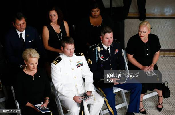 Cindy McCain wife of Sen John McCain RAriz sits with her sons Jack Jimmy and daughter Meghan right during a memorial service at the Arizona Capitol...