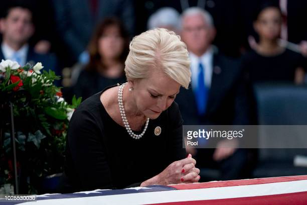 Cindy McCain wife of Sen John McCain RAriz stands over her husband's casket as he lies in state in the Rotunda of the US Capitol on August 31 2018 in...