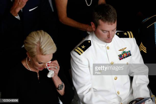 Cindy McCain wife of Sen John McCain RAriz wipes a tear away next to her son Jack during a memorial service at the Arizona Capitol on August 29 2018...