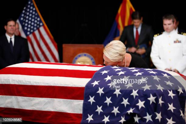 Cindy McCain wife of Sen John McCain touches the casket during a memorial service at the Arizona Capitol on August 29 in Phoenix Arizona John McCain...