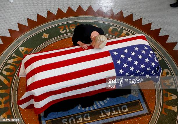 Cindy McCain wife of Sen John McCain touches the casket during his memorial service at the Capitol on August 29 2018 in Phoenix Arizona Sen McCain a...