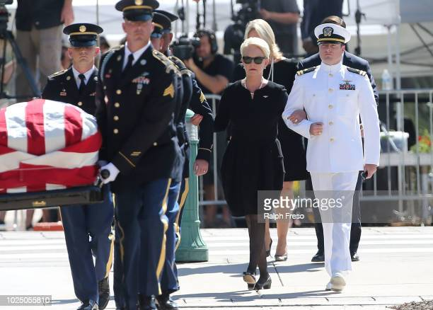 Cindy McCain wife of Sen John McCain walks behind her husband's casket as its carried to the Arizona State Capitol Rotunda where it will lie in state...