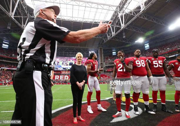 Cindy McCain, wife of the late U.S. Sen. John McCain, R-Ariz., stands with Arizona Cardinals' Larry Fitzgerald, Patrick Peterson, Corey Peters and...