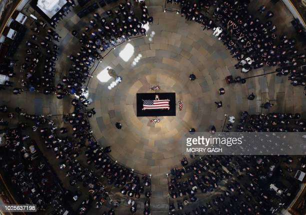 TOPSHOT Cindy McCain wife of the late US Sen John McCain stands over his casket as he lies in state in the US Capitol Rotunda Friday Aug 31 in...