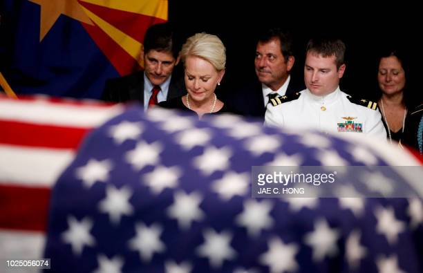 TOPSHOT Cindy McCain wife of the late US Senator John McCain sits with her son Jack during a memorial service at the Arizona Capitol on August 29...