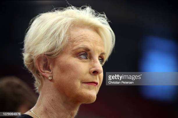 Cindy McCain wife of the late US Senator John McCain stands on the sidelines before the game between the Arizona Cardinals and the Washington...