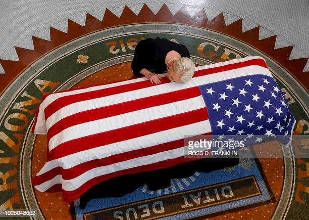 TOPSHOT Cindy McCain wife of US Senator John McCain kisses his casket during a memorial service at the Arizona Capitol on August 29 in Phoenix