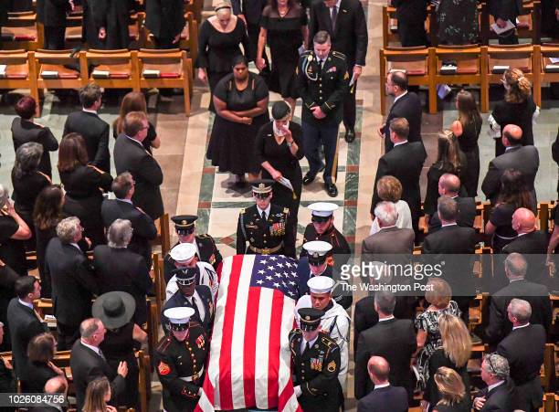 Cindy McCain wipes away tears as she follows the casket out of thefuneral service for her husband at the National Cathedral for Sen John S McCain a...