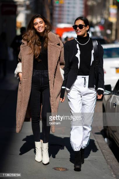 Cindy Mello and Gizele Oliveira are seen in SoHo on March 16 2019 in New York City