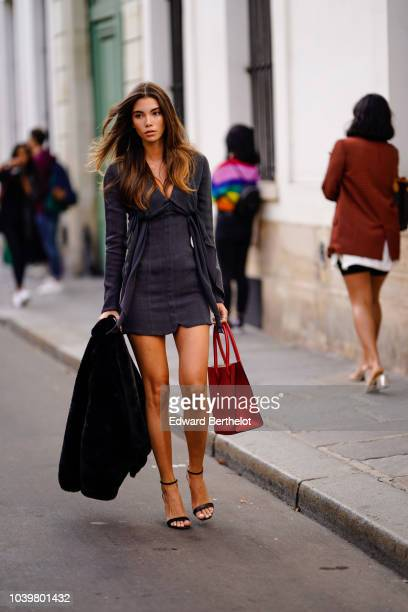 Cindy Mello wears a gray dress outside Jacquemus during Paris Fashion Week Womenswear Spring/Summer 2019 on September 24 2018 in Paris France