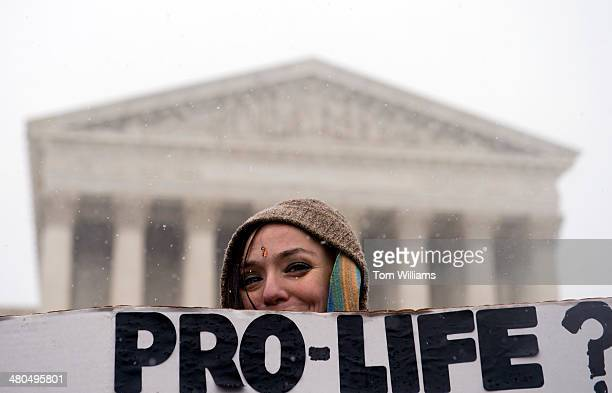 Cindy O'Ferrell of Northern Va., attends a rally outside of the Supreme Court during opening arguments of Sebelius v. Hobby Lobby Stores. The case...