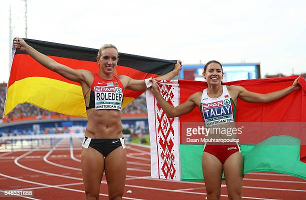 Cindy Roleder of Germany and Alina Talay of Belarus celebrate after winning medals in the final of the womens 100m hurdles on day two of The 23rd...
