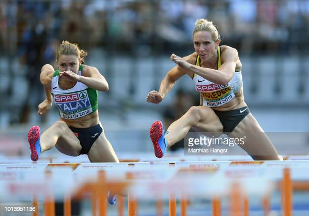 Cindy Roleder of Germany and Alina Talay of Belarus compete in the Women's 100 metres hurdles semi finals during day three of the 24th European...