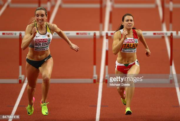 Cindy Roleder of Germany and Alina Talay of Belarus compete in the Women's 60 metres hurdles final on day one of the 2017 European Athletics Indoor...