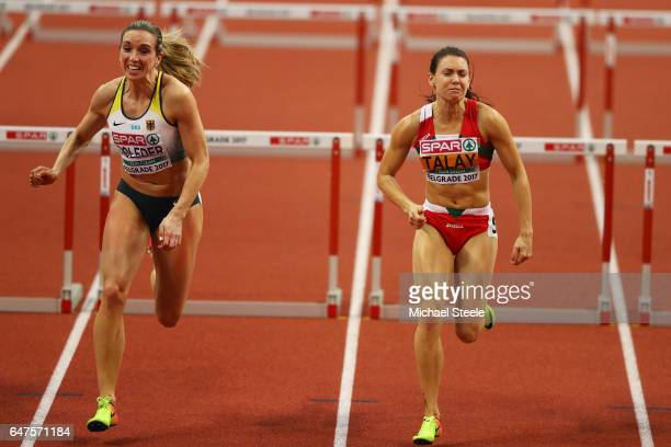 Cindy Roleder of Germany and Alina Talay of Belarus competes in the Women's 60 metres hurdles final on day one of the 2017 European Athletics Indoor...