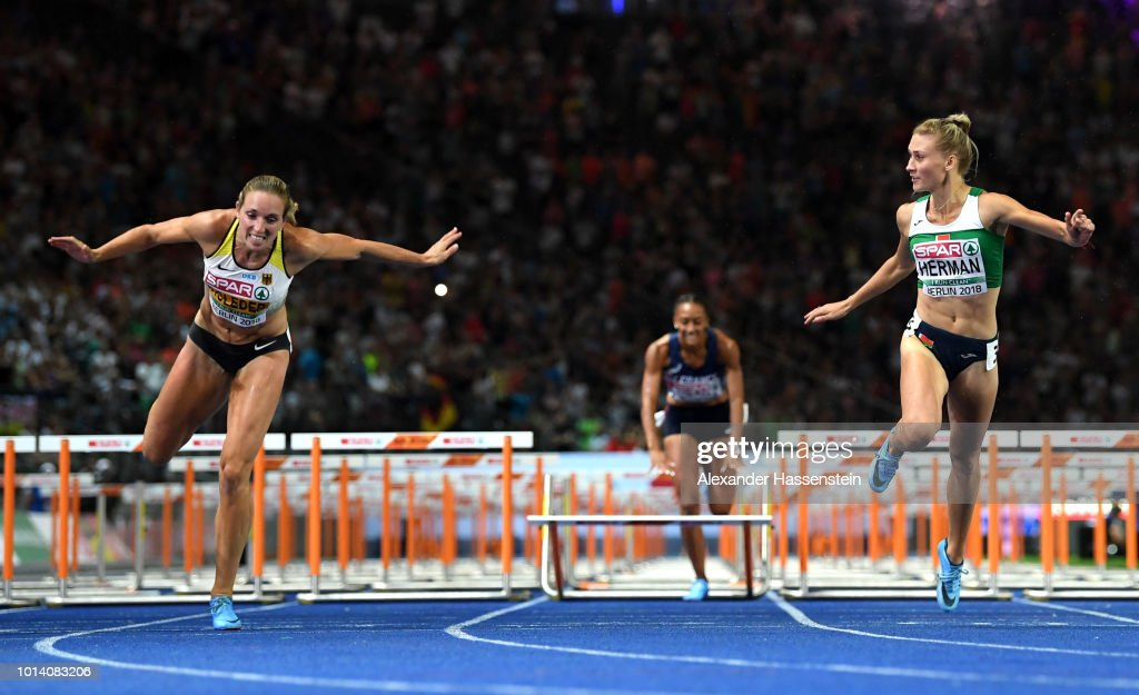 Cindy Roleder of Germany and Elvira Herman of Belarus cross the finish line in the Women's 100m Hurdles Final during day three of the 24th European Athletics Championships at Olympiastadion on August 9, 2018 in Berlin, Germany. This event forms part of the first multi-sport European Championships.