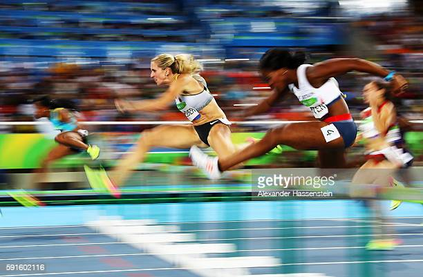 Cindy Roleder of Germany and Tiffany Porter of Great Britain compete in the Women's 100m Hurdles Semifinals on Day 12 of the Rio 2016 Olympic Games...