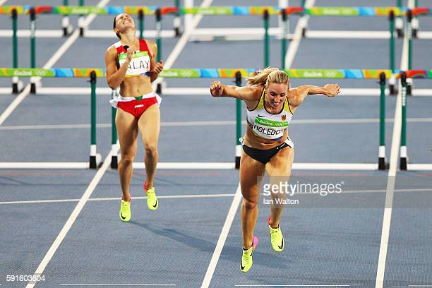 Cindy Roleder of Germany competes in the Women's 100m Hurdles Semifinals as Alina Talay of Belarus reacts on Day 12 of the Rio 2016 Olympic Games at...
