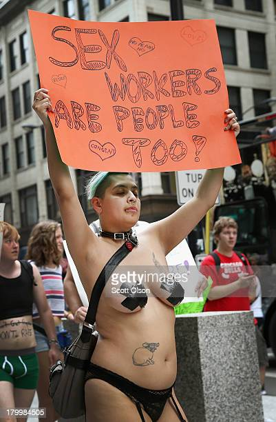 Cindy Rosillo marches through downtown during Slutwalk on September 7 2013 in Chicago Illinois Slutwalk which was started in Toronto in 2011 is a...