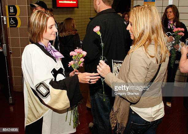 Cindy Sabourin wife of Dany Sabourin of the Pittsburgh Penguins hands out carnations during Hockey Fights Cancer night on October 18 2008 at Mellon...