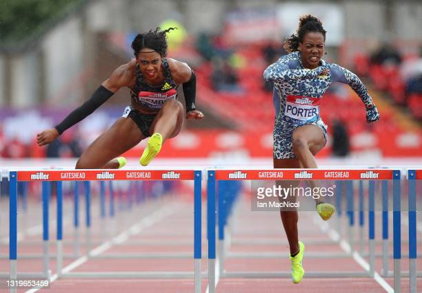Cindy Sember of Great Britain clears the final hurdle to win the Women's 100 metres Hurdles alongside Tiffany Porter of Great Britain during the...