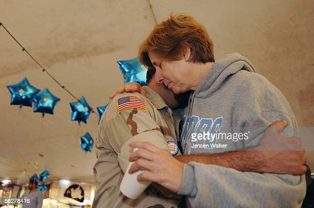 Cindy Sheehan hugs Gulf War veteran Charles Anderson in the Camp Casey tent on November 26 2005 in Crawford Texas Cindy Sheehan supported by the...