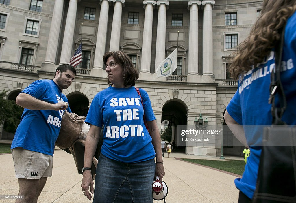 Cindy Shogan, center, executive director of the Alaska Wilderness League, stands with other activists outside of the Environmental Protection Agency headquarters to urge that Shell Oil be denied a waiver from pollution regulations for their Arctic Ocean drilling operations on July 23, 2012 in Washington, DC. The members of Greenpeace, the Alaska Wilderness League and other environmental groups wanted to deliver a petition to EPA Administrator Lisa Jackson but were told to email the petition instead. Shell Oil has asked the EPA for revisions to its air permit to allow for higher levels of pollution from the company's Arctic Ocean drilling fleet.