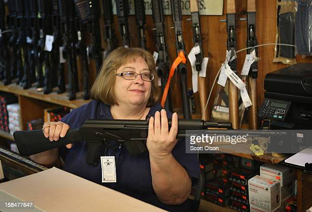 Cindy Sparr boxes a AK47 style rifle purchased by a customer at Freddie Bear Sports sporting goods store on December 17 2012 in Tinley Park Illinois...