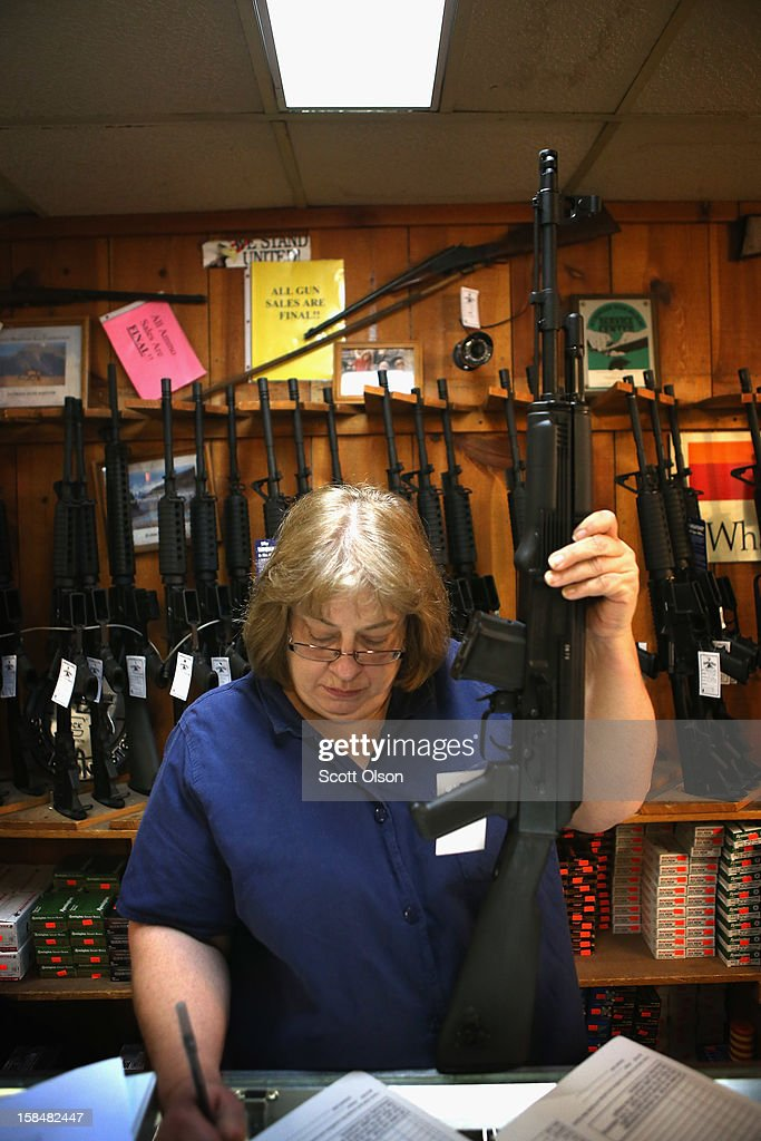 Cindy Sparr fills out the required paperwork after selling a customer an AK-47 style rifle at Freddie Bear Sports sporting goods store on December 17, 2012 in Tinley Park, Illinois. Americans purchased a record number of guns of guns in 2012. Gun sales have surged recently with people buy guns for personal protection following the mass shooting in Connecticut and gun enthusiasts buying guns because they fear a reinstatement of the assault weapons ban. About 47 percent of Americans own guns.