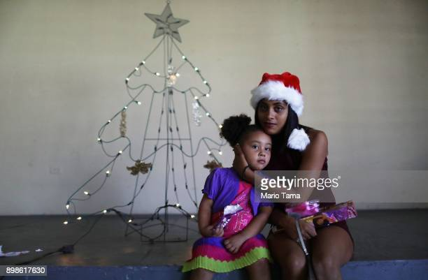 Cindy Vazquez Cruz poses with her daughter Ruby Alamo in the shelter for Hurricane Maria victims where they currently reside in front of the...